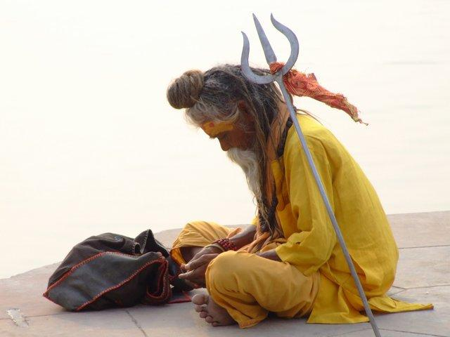 Sadhu, counting his money