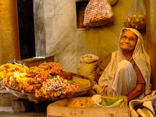 the lady sells flowers