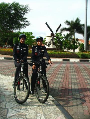 cycling police-woman