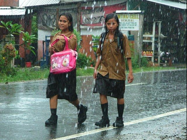 schoolgirls in the rain