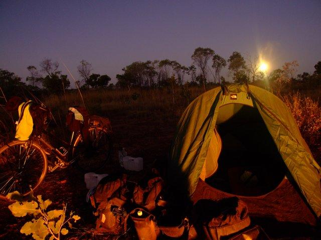 camp with a full moon