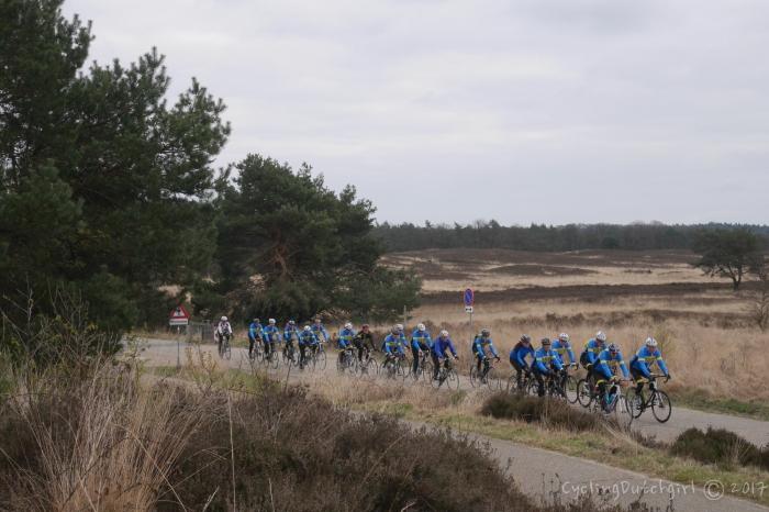 many riders riding.